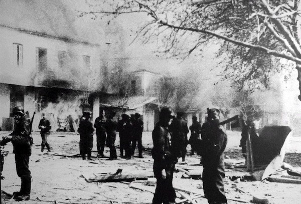 epa01561027 A file photo reportedly taken on 10 June 1944 by an anonymous German soldier shows German occupation troops in the ransacked south-central Greek town of Distomo, Thebes prefecture, shortly after 218 local residents were executed as part of Nazi reprisals for the activity of partisans in the area. An appellate court in Florence, Italy, on 25 November 2008 ruled that a verdict handed down by Greek first instance court ordering the German state to pay 50 million euros in damages to victims' families is valid. A constitutional court ruled in 1992 that cases involving Nazi massacres or mass executions can be tried in Italy, regardless of whether the crime was committed in a third country.  EPA/STR BLACK AND WHITE ONLY